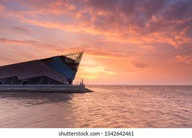 HULL, ENGLAND - OCTOBER  2, 2013: The Deep is a submaquarium at the confluence of the River Hull and the Humber estuary and this was a beautiful orange and red sunrise