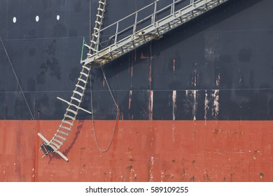 Hull of a freight vessel with pilot ladder