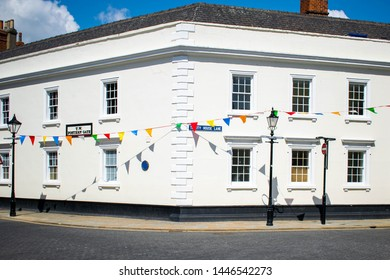 Hull, UK - 12 May 2019: Hull Trinity House Building on Trinity House Lane in the Old Town Hull, Yorkshire, England. Decorated with colourful vibrant flags for summer celebrations and city of culture