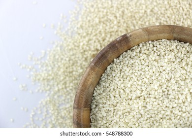 Hulled White Sesame with Unfocused Seeds in Background.