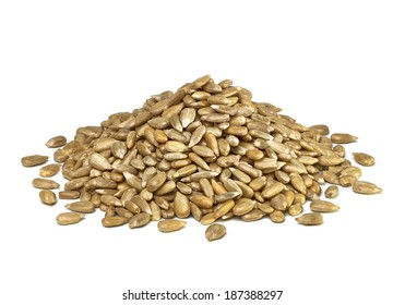 Hullled sunflower seeds pile on white background