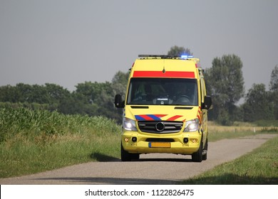 HULST, HOLLAND - JUL 11, 2015:  an ambulance drives in the countryside in spring