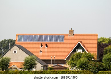 Hulst, Holland - jun 29, 2018: a row of solar panels at a modern roof of a house in the dutch countryside in summer