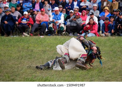 Hulunbuir, Inner Mongolia / China - Aug 09 2019: A scene of Mongolian wrestling, as one of sports in Nadam Fair (a Mongolian traditional festival).