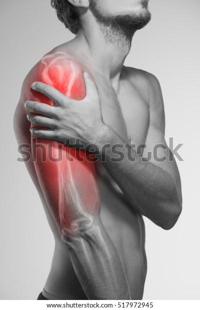 Schmerzen am menschlichen Arm. Anatomie des menschlichen Arms.