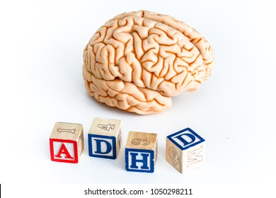 human brain with ADHD written made with cubes, on white background