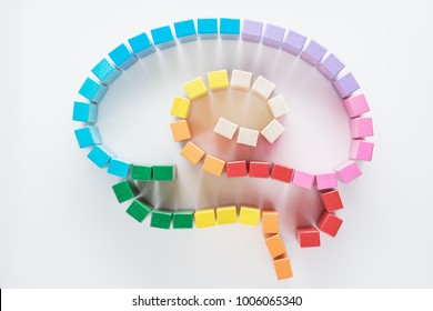 Human brain is made of multi-colored wooden blocks. Top view, flat lay.