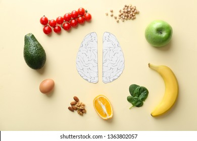 Human brains with different healthy products on color background