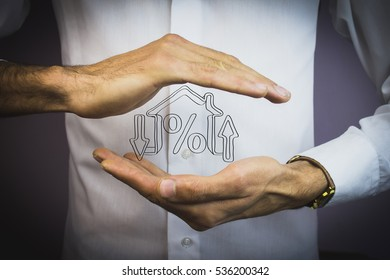 human  by holding a house and percent sign