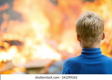 Human child boy at burning house fire accident background