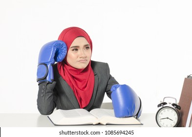 Human emotion expression feeling concept, stressed young business woman with boxing glove read a book