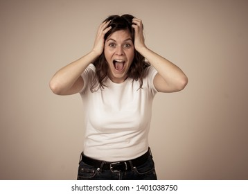 Human emotions and expressions. Portrait of beautiful shocked woman hearing unexpected news, winning or having great success with surprised and happy face making cheerful gestures. Studio shot.
