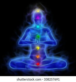Human energy body with aura and chakras in meditation.