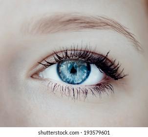 Human eye close-up. Macro shot. Color toned image.