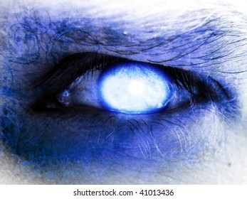 human eye with a glowing blue pupil in it