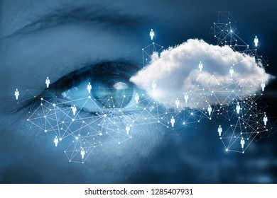 A human eye is looking at the networking cloud inside a scheme consisted of wireless connections and person image icons at the dark background.