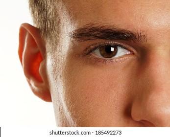 Human eye of man with long eyelashes close up