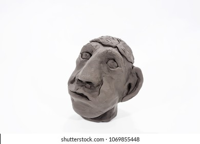 Human face made from Play Clay. Isolated on white background.