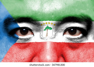 Human face painted with flag of Equatorial Guinea.