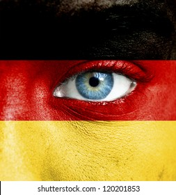 Human face painted with flag of Germany