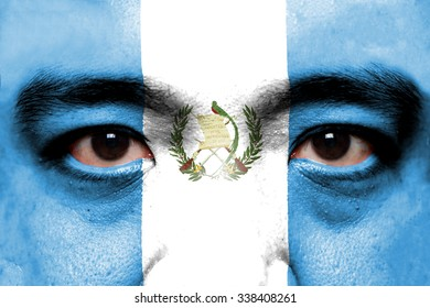 Human face painted with flag of Guatemala.