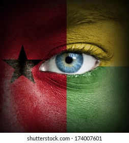 Human face painted with flag of Guinea-Bissau