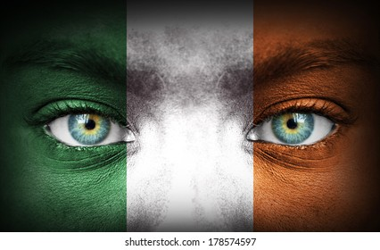 Human face painted with flag of Ireland