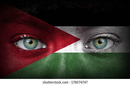 Human face painted with flag of Jordan
