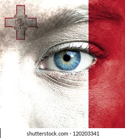 Human face painted with flag of Malta