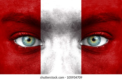 Human face painted with flag of Peru