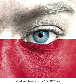 Human face painted with flag of Poland