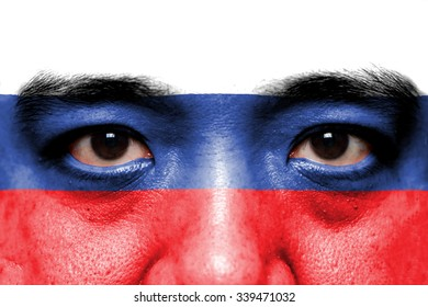 Human face painted with flag of Russia.