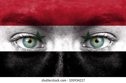 Human face painted with flag of Syria