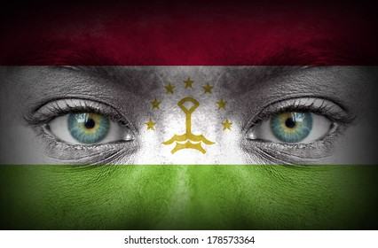 Human face painted with flag of Tajikistan