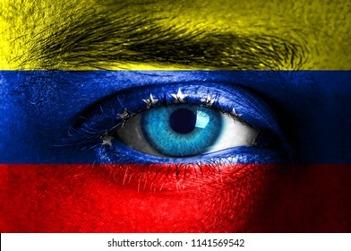 Human face painted with flag of Venezuela