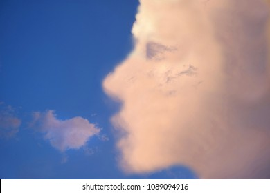 human face shaped clouds in the sky