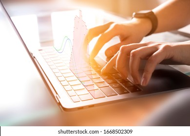 Human Female Hands working on PC grey Laptop with analytical chart on office background with sun light effect. Freelance worker. Productivity, planning concept. Online trading
