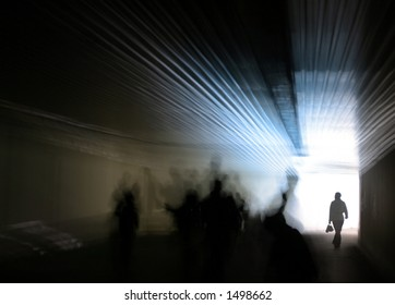 Human figures are walking towards the glowing entrance of a dark passage