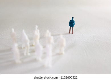 human figurine standing on white background representing leadership
