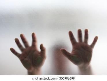 Human finger on glass background