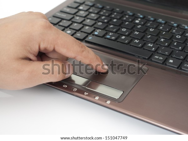 Human finger on the Touchpad and Keyboard