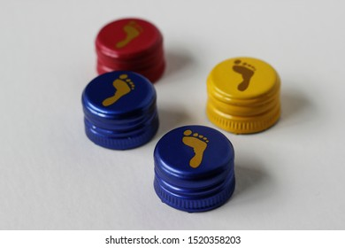 Human foot prints illustrated on colorful wines bottle caps