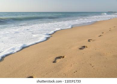 Human footprints on the sand beach