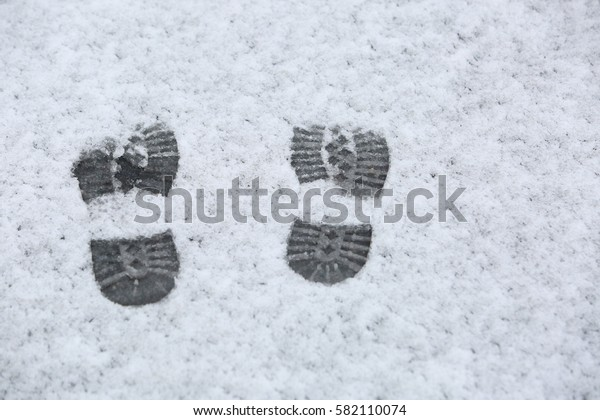 Human footprints in the sleet.