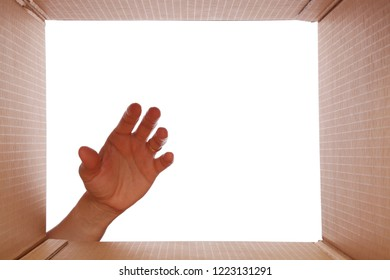 Human hand about to take something from a box. Point of view from the bottom of the box