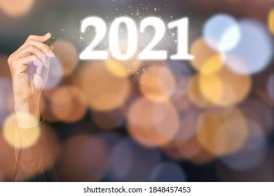 Human hand and the beginning of 2021 - Shutterstock ID 1848457453