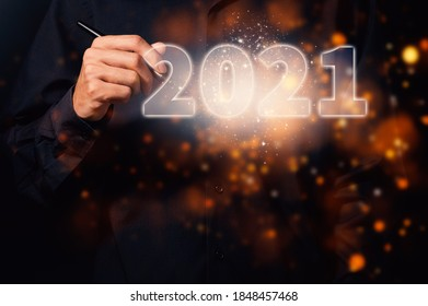Human hand and the beginning of 2021 - Shutterstock ID 1848457468