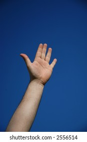 human hand and the blue sky as background