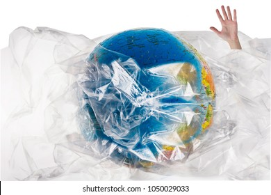 Human hand comes out of the plastic near the globe , human sinks in the plastic, social advertising, world environment day concept