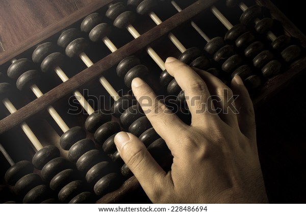 Human hand counting with abacus.